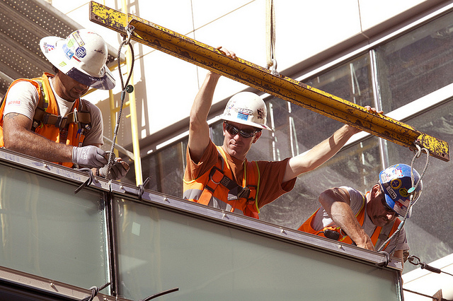 For construction and rooftop workers, safety eyewear is a must––especially during busy summer days. Photo by NAVFAC, via Flickr with Creative Commons License